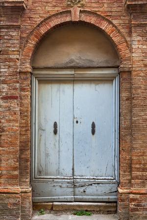 Old elegant door of Tuscan Italy photo