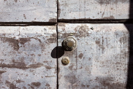 keylock: an old wooden and grungy locked door typical of the tuscany,  Italy
