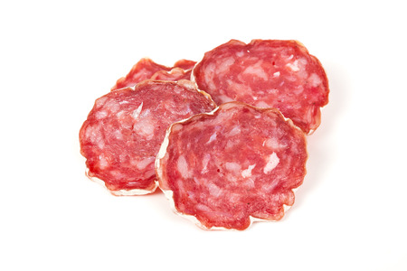 embutido: pile of red salami, isolated on a white background