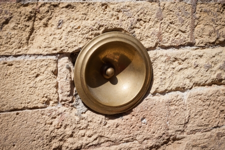 porter house: antique bell calling porter, on the wall, Italy Stock Photo