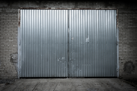 Industrial building made of grungy concrete with door photo