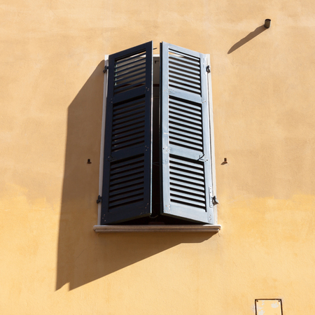Typical italian window with closed shutters photo