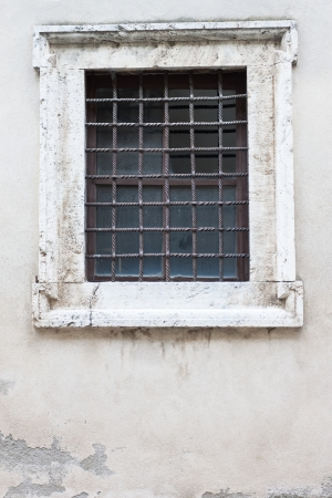 old and aged window of a traditional house photo