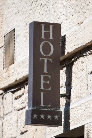 warmly: Hotel sign on the old wall Stock Photo