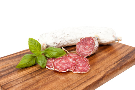 air dried salami: salami sausage on wooden board background