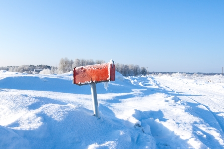 winter frozen mail box under snow photo