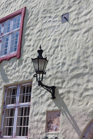 Old-fashioned lantern on the wall photo