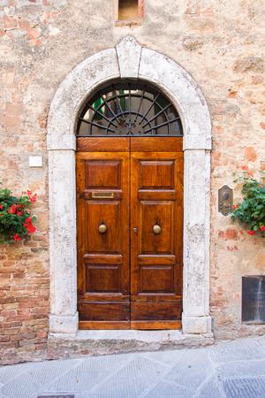 Old elegant wooden door in italian vilage photo