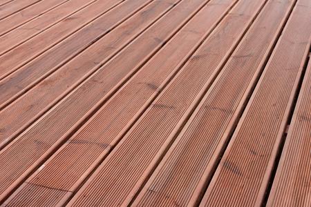 terrasse en bois humide texture chaussée de fond