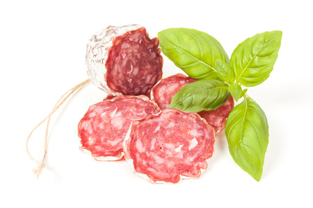 Salami sliced isolated on the white background photo