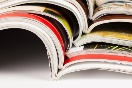Stack of color magazines on white