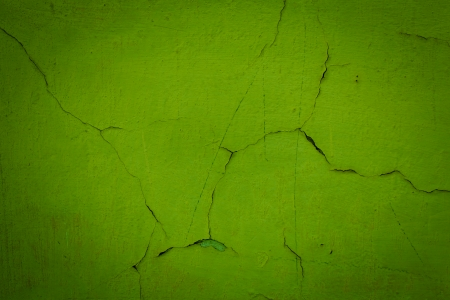 Green dark grungy wall background or texture photo