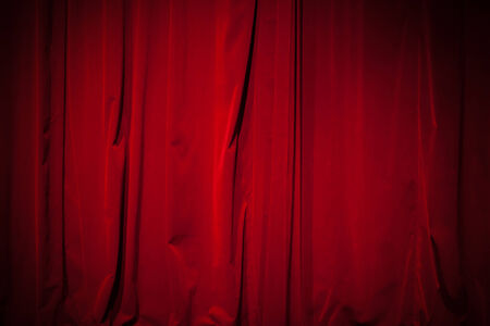 Curtain from the theater with a spotlight as background photo