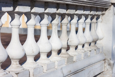 Closeup of a stone balustrade in white photo