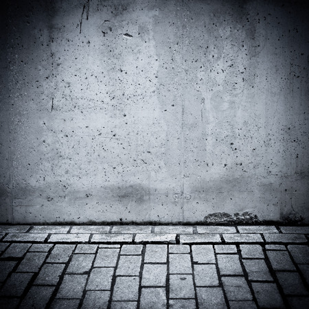 Grungy concrete wall and stone floor room as background photo