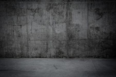 汚れたコンクリート壁と背景として石造りの床の部屋