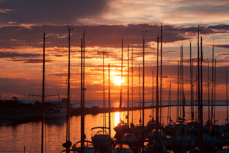 harbour and the yachts at dramatic sunset photo