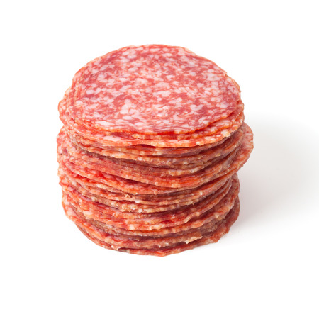 slices of salami isolated on a white background Imagens