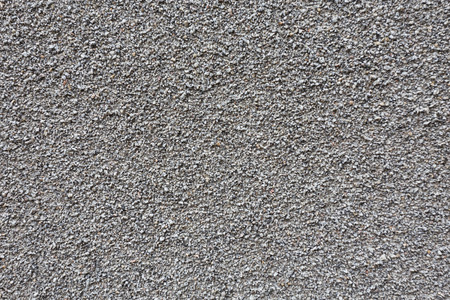 Gray small granite stone floor background texture photo