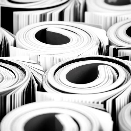 Colorful magazines up close - rolled up composition photo