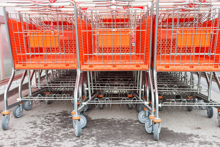 grocery store series: Shopping carts on a parking lot . Detail of a shopping cart Stock Photo