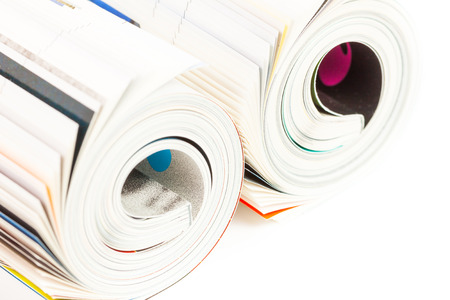 rolled up magazine - on white background photo