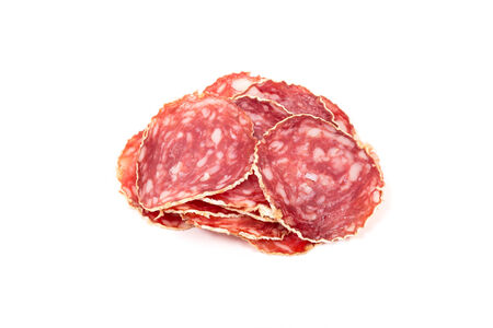 Slices of salami sausages isolated on a white background photo