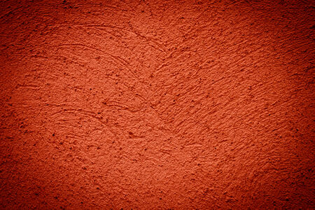 Red plaster grunge background wall dirty texture photo