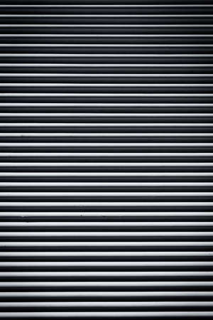 Striped gray concrete wall as a background texture photo