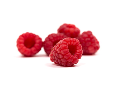 ripe red raspberry isolated on white background photo