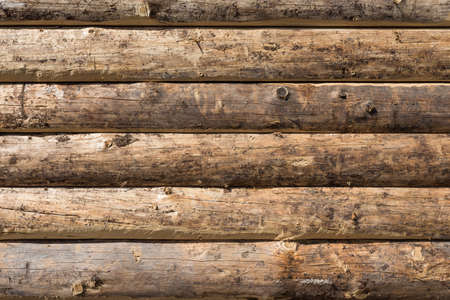 Wooden wall from logs as a background texture photo