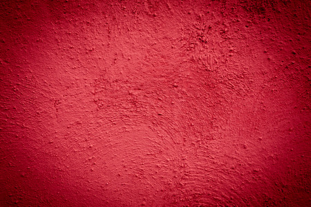Red background wall texture with dark edges photo