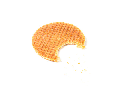 food waffle with caramel crumbs isolated on white background photo