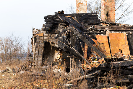 burned out: The charred ruins and remains of a burned down house Stock Photo