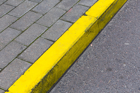 kerb: Yellow kerb line on the asphalt proad
