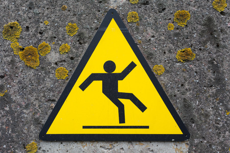 beware: Sign beware slippy on concrete wall