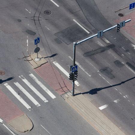 cross walk: high angle view of an empty street intersection with cross walk markings, traffic signal lights
