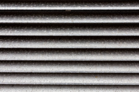 corrugated steel: Dirty dark metal fence - background texture Stock Photo