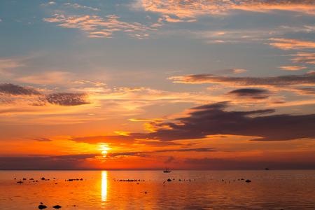 tall ship sailing along skyline during sunset photo