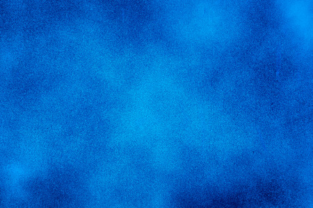 Blue texture background with bright center spotlight photo