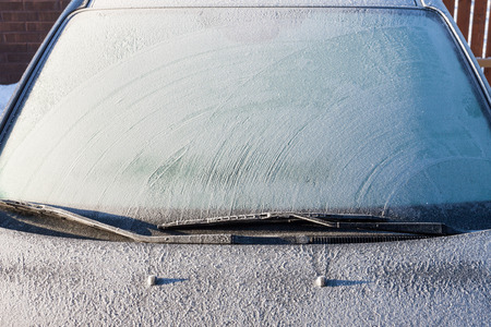 Snow covered car windshield - winter image Stok Fotoğraf