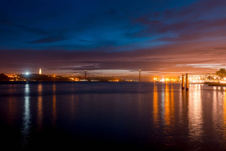 Night view on river Tejo (Lisbon, Portugal) photo