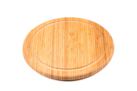 low perspective: Round Bamboo Chopping Board from low perspective isolated against white background.