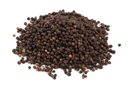 Black pepper was placed on a white background and isolated Stockfoto