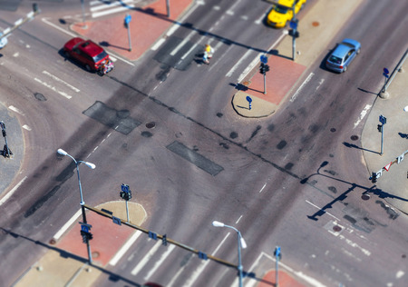 cross walk: high angle view of a street intersection with cross walk markings, traffic signal lights - tilt shift Stock Photo