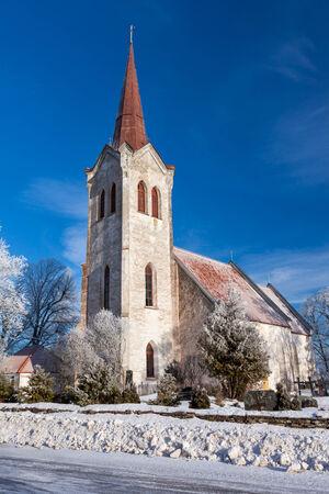Church in rural place, winter shot in Estonia photo