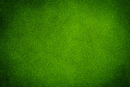bright center: Green dark texture background with bright center spotlight