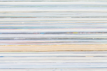 close-ups of stack of colorful magazines - publications photo