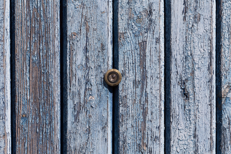 eyewitness: door lens peephole on old wooden texture