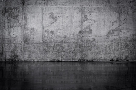Grungy dark concrete wall and wet floor photo